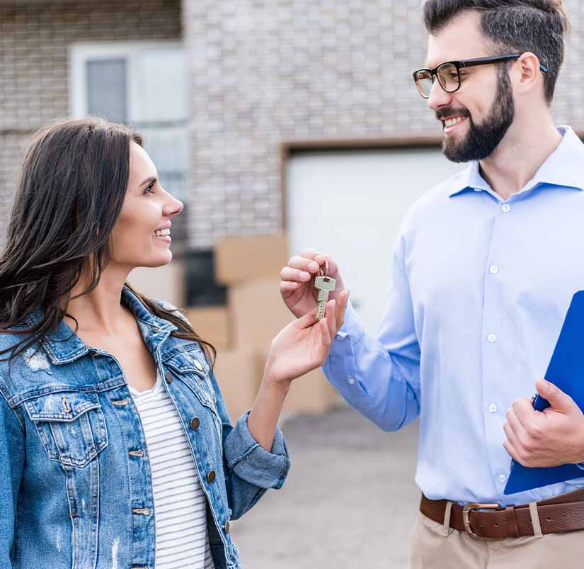 client and professional with a key to new property